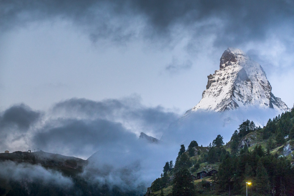 The peak of Matterhorn still covered with a few clouds.