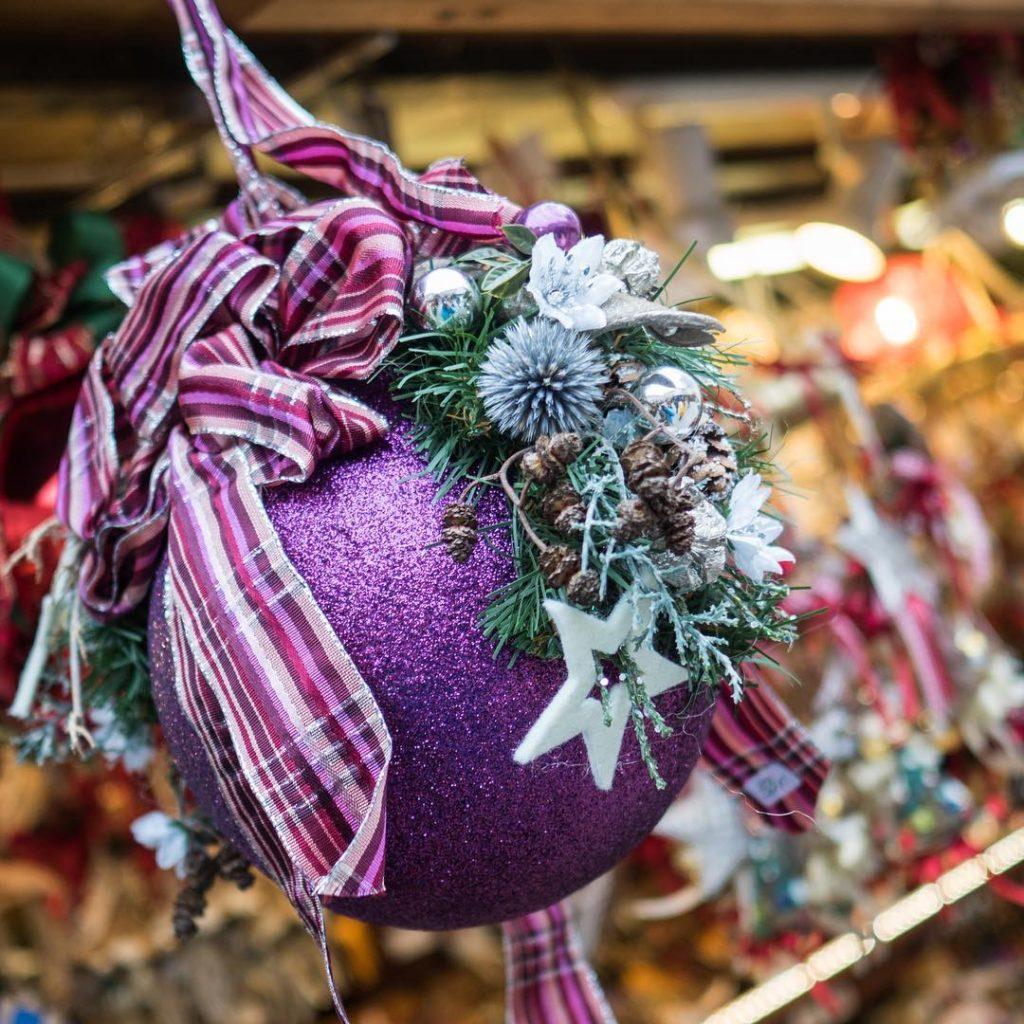 Christmas ball in purple colour on salzburger Christkindlmarkt tripcendo mylifeoutsidehellip