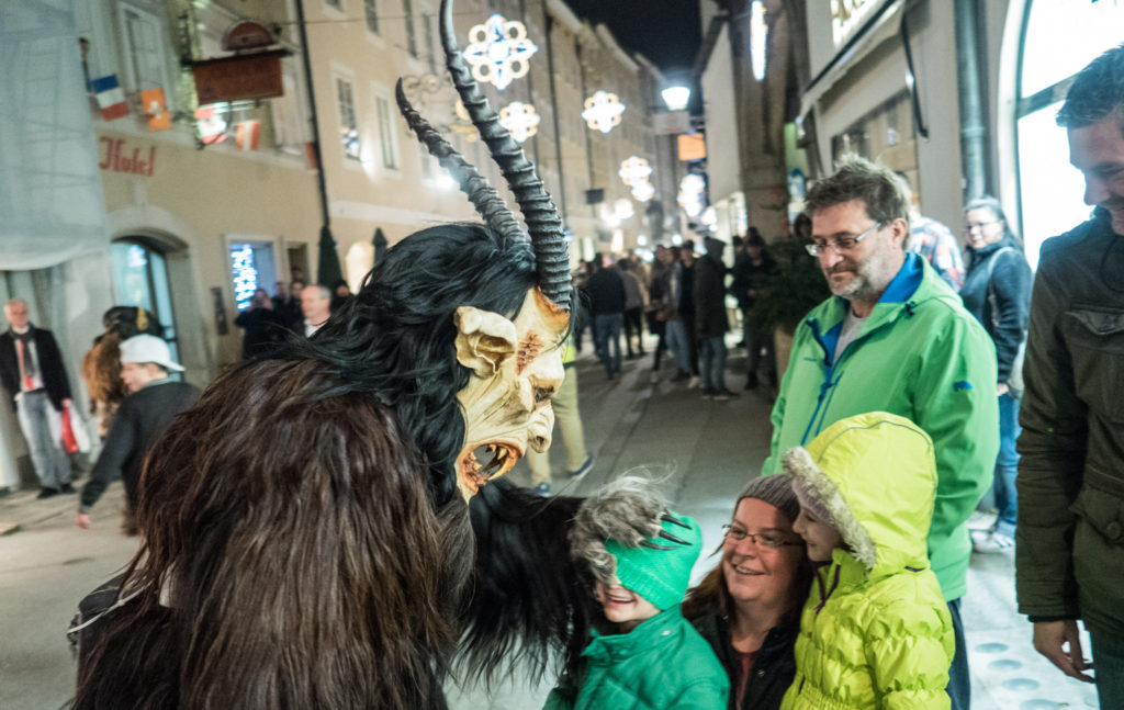 Krampus with a boy in Saltzburg